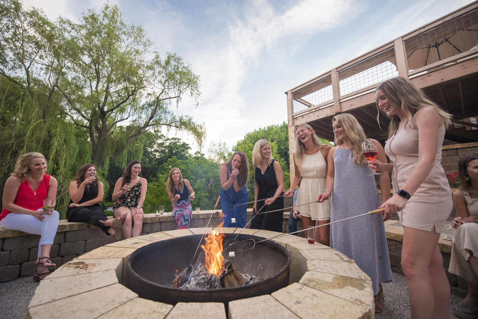 Women making s'mores at Chankaska Creek Ranch & Winery