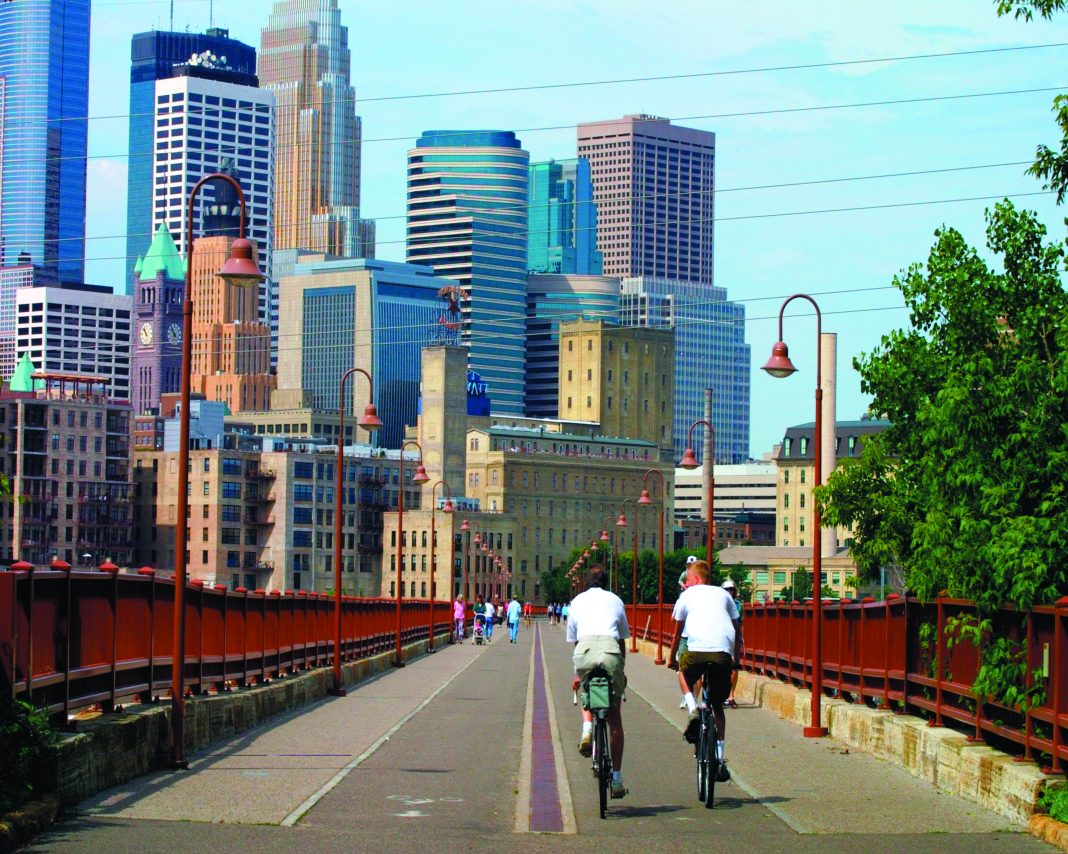 Bikers on the Stone Arch Bridge in downtown Minneapolis