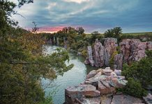 Pink sunset over Palisades State Park's pink Sioux quartzite cliffs