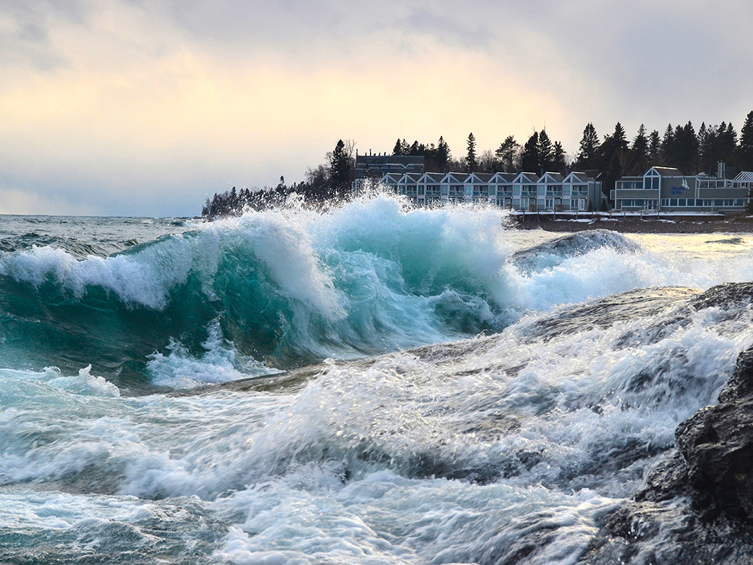 A lakeside resort with huge waves crashing to shore off Lake Superior