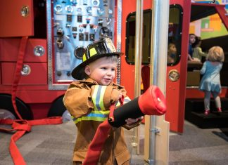 little boy dressed up like a firefighter at Science Museum of Minnesota
