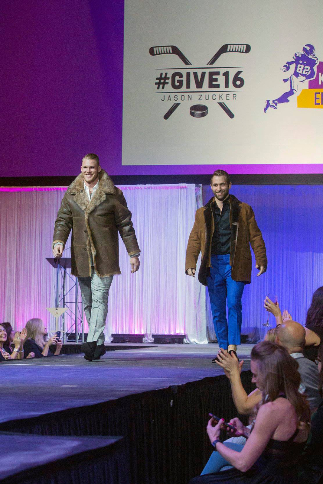 Minnesota Vikings tight end Kyle Rudolph and Minnesota Wild left wing Jason Zucker walk the runway at FashionFest 2018.