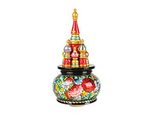 An intricate Russian music box with colors of red, green, blue, purple, yellow, and black.
