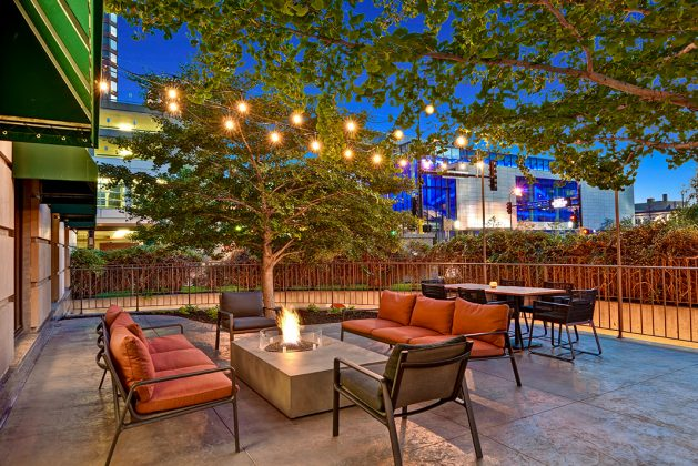 Outdoor seating around a fire pit on the patio of a new restaurant in Minneapolis.