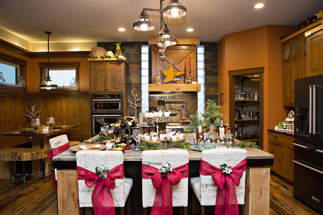 A wood, rust orange, and dark stone kitchen decorated for the holidays.