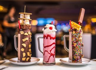 Three milkshakes with sugary toppings