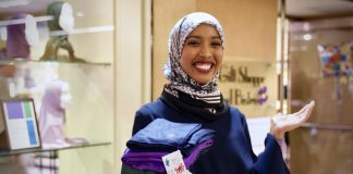 Hilal Ibrahim at Park Nicollet Methodist holding her hijabs.