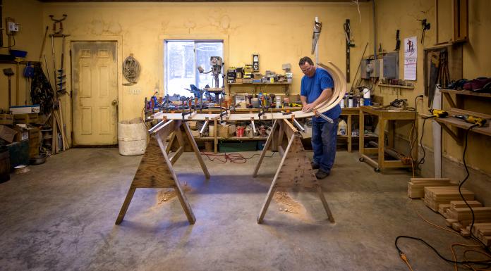 John Harren builds a toboggan in his workshop near Warroad