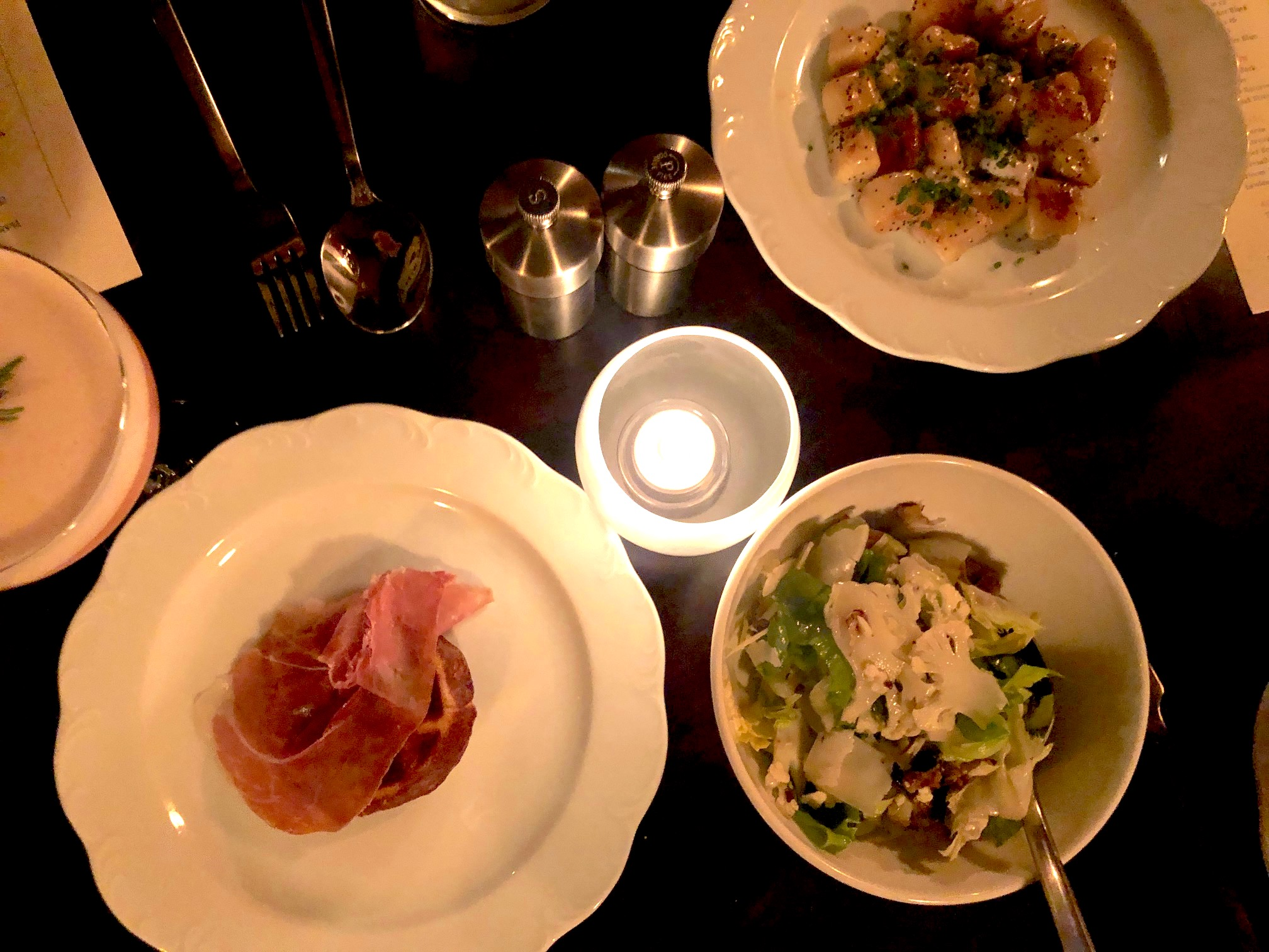 At Snack Bar, guests are encouraged to assemble a collection of small plates. Clockwise from top: Sweet Potato Gnocchi & Stracchino Cheese; Pickled Cauliflower Salad; and the Parmesan Waffle with Prosciutto di Parma