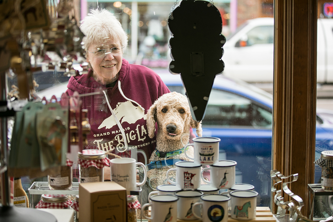 A woman and her dog window shopping in Cook County, Minnesota.