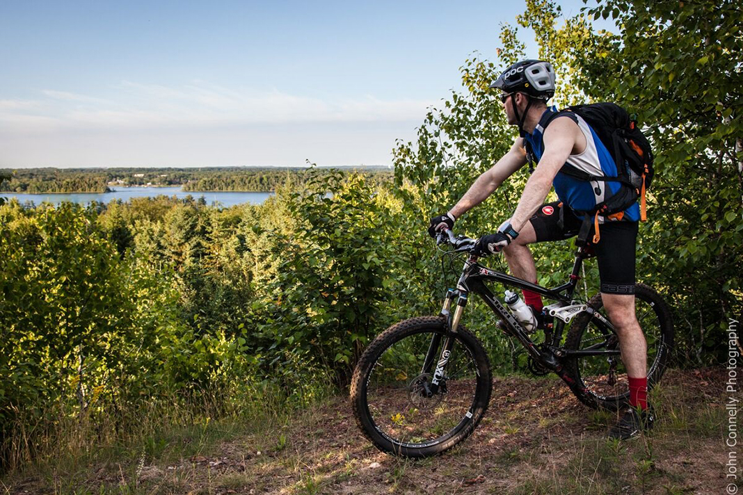 A man on a bike overlooking Grand Rapids