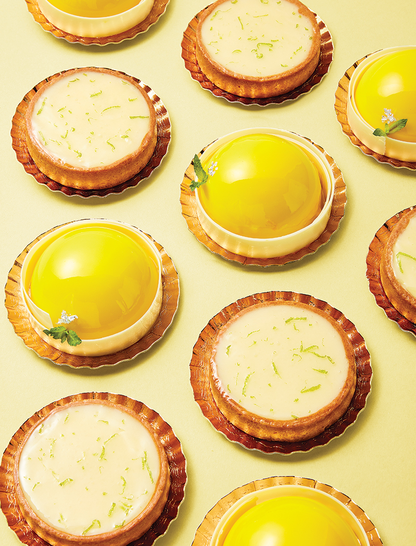 """At Patisserie 46: The yellow ones are Rory Roses (vanilla and caramel cream with caramel sponge and pecan """"crunchy""""), and the white ones are Lemon Tarts (traditional lemon yuzu custards with lime-scented cream)"""