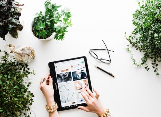 A woman with a tablet and plants. Brooke Lark/Unsplash
