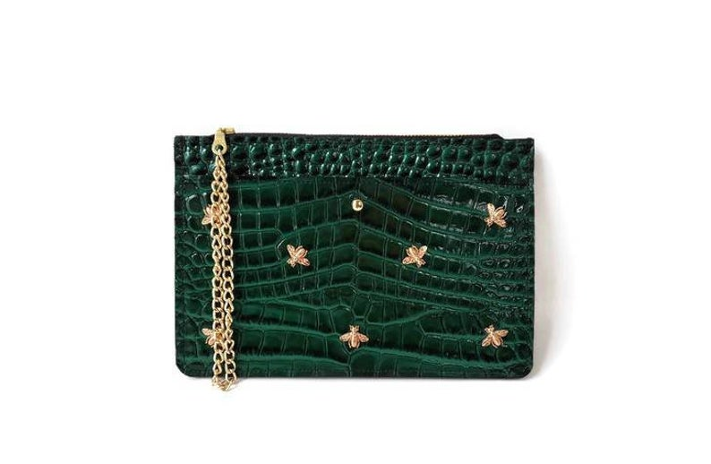 At 6-by-9 inches, this green clutch is easy to tote around with a wrist strap and comes with a zipper compartment as well as a phone pocket.