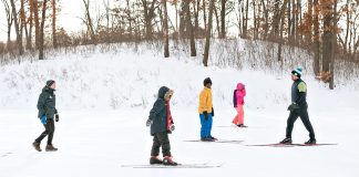 Ray Aponte (right) leads kids from North Minneapolis in cross-country skiing at Theodore Wirth Park