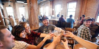 Friends enjoying a beer at Indeed Brewing Co., one of many Minnesota breweries