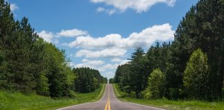 driving through Minnesota on an empty road