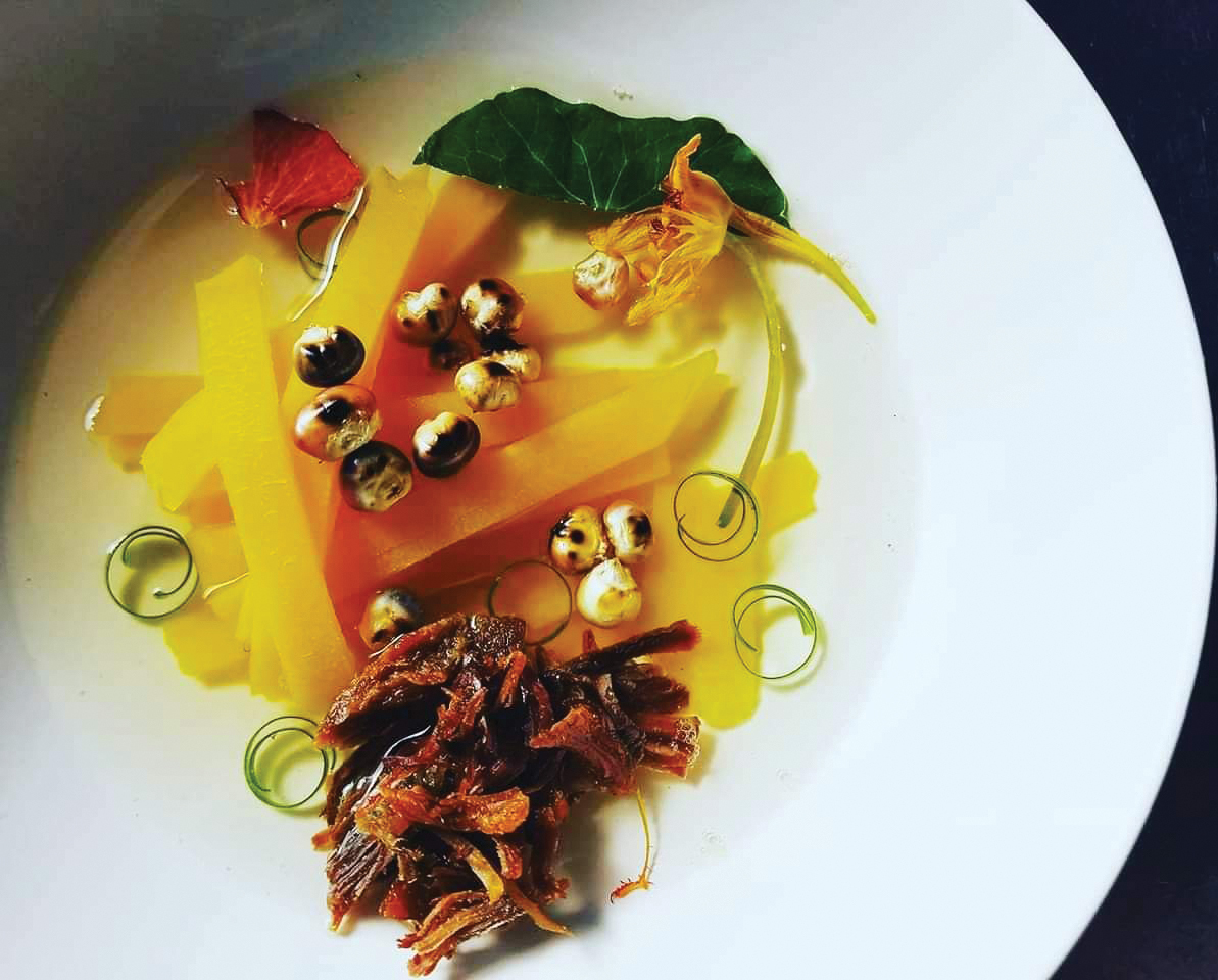 Wild and cultivated edibles in chokecherry and bison broth