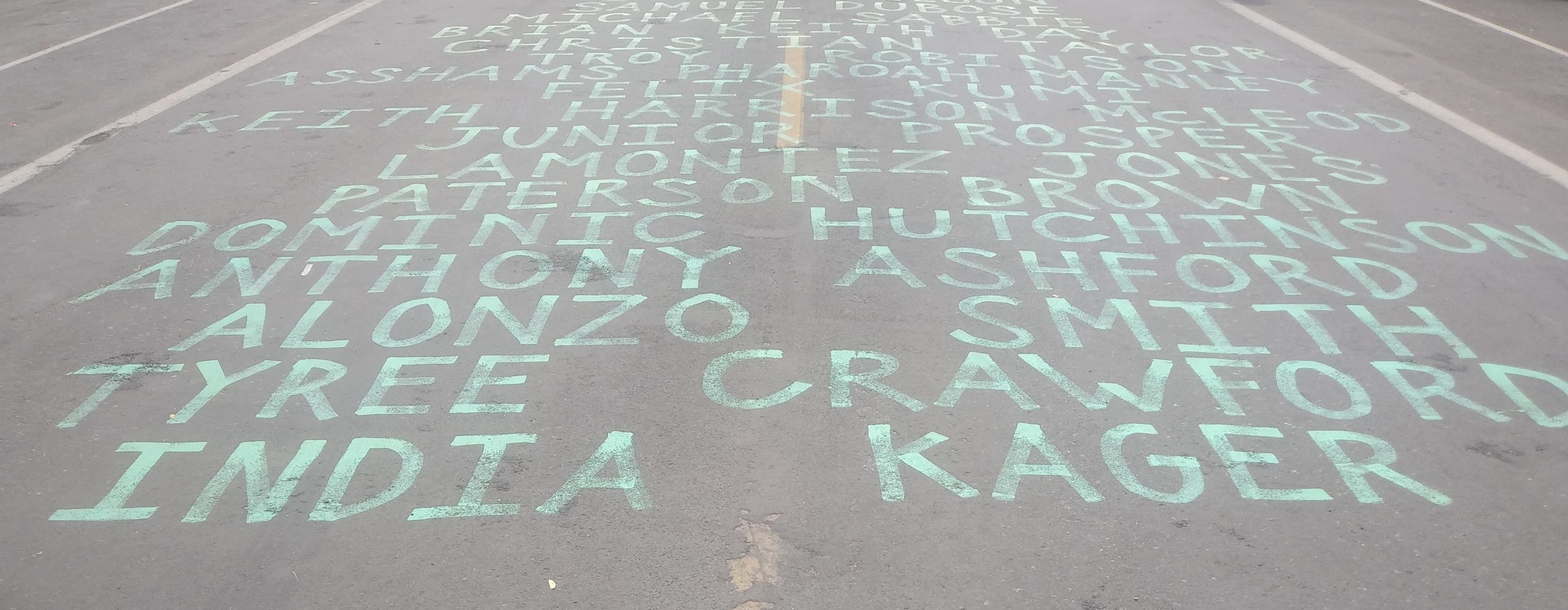 Between June 2 and June 4, Mari Hernandez painted 34 more names to the list running down Chicago Avenue
