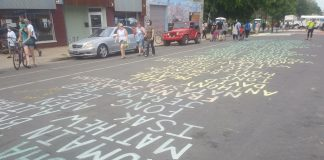 The list of names painted on Chicago Avenue keeps growing as more people send names